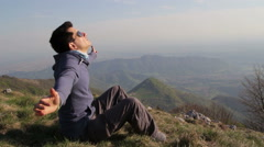 Boy relaxes and lulled by the wind Stock Footage