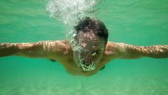 Underwater View of a Tourist, Swimming in the Tropical Sea Stock Footage