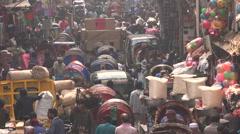 Cycle rickshaws in a busy market in Dhaka, Bangladesh - stock footage