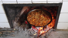 Paella Cooking a Wood Fire Stock Footage