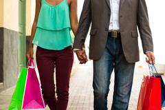 African American Couple Shopping With Bags In Panama City - stock photo