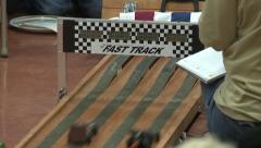 Pinewood Derby cars race track finish line Stock Footage