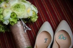 Wedding shoes and bouquet Stock Photos