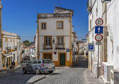 Portugal , Évora . Stone houses and streets, paved with stone - stock photo