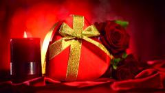 Valentine Red Heart, Gift box and Red Rose Flower on Red Silk Background Stock Footage