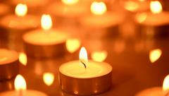 Candles light background. Candle flame at night Stock Footage