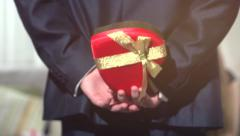 Valentine's Day gift. Yong man giving Valentine gift box to his girlfriend. Stock Footage