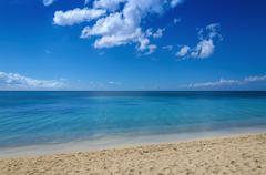 Endless sea and beautiful sandy beach Stock Photos