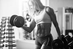 Strong woman bodybuilder - stock photo
