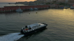 SNAV ferry pulls into Naples, Italy harbor at sunset - 4K UHD 0240 Stock Footage