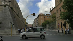 Busy traffic Rome street corner outside Vatican fortress wall - HD-P 0286 Stock Footage