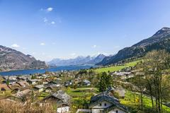 landscape of Sankt Gilgen with the Wolfgangsee and the alps - stock photo