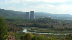 Nuclear power plant by the meandering river, wider - stock footage