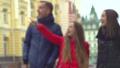 Tourist family walking by the city. Amazed Girl showing landmarks Stock Footage
