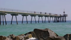 Footbridge over the sea with people walking.Time Lapse - stock footage