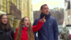 Tourist family Enjoying sights of town. Amazed Girl showing landmarks. - stock footage