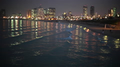 Tel-Aviv coastline from Jaffa at night, shallow focus - stock footage