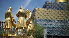 Statue of early industrialists in front of the Library of Birmingham. Stock Footage