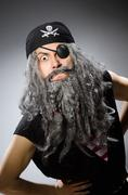 Man in pirate costume isolated on gray Stock Photos