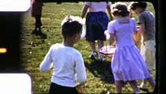 Wild Boy EASTER EGG Hunt Holding Basket 1960s Vintage Retro Film Home Movie 8492 Stock Footage