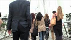 People walking across the London Golden Jubilee Footbridge Stock Footage