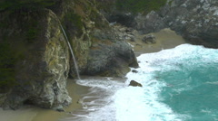 The McWay Waterfall Trickles off into the Ocean at Big Sur - stock footage