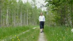 Man is aproaching in the forest Stock Footage