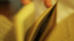 Reading book, extreme close up, shallow focus Stock Footage