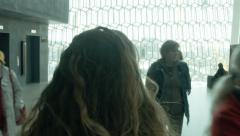 Tourist Walks through the Harpa in REYKJAVIK, ICELAND Stock Footage
