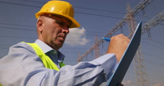 Electrician Engineer Maintains Electrical Equipment Writing Note Maintenance Man - stock footage