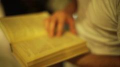 Reading mathematics book, close up, shallow focus Stock Footage