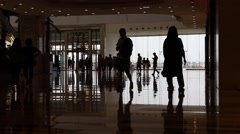 Silhouettes of people walking in the shopping mall Stock Footage