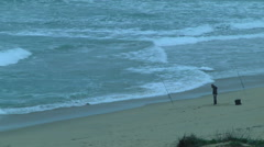 A Fisherman Examines Her Lines on the Pacific Coast Stock Footage