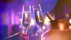 Two glasses with sparkling champagne over holiday blinking background Stock Footage