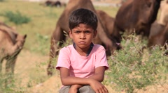 Video 1920x1080  Young boy and camel involved in Pushkar Camel Mela. India Stock Footage