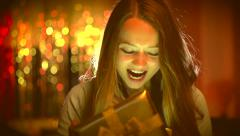 Beauty girl opens Christmas gift box with magic gift - stock footage