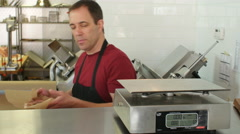 Butcher weighing beef on a scale at the counter Stock Footage