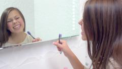 Beauty teenage girl with toothbrush singing and dancing Stock Footage