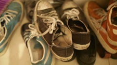 Colorful used pile of shoes, close up, shallow focus - stock footage