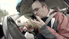 A family eating fast food in their car traveling Stock Footage