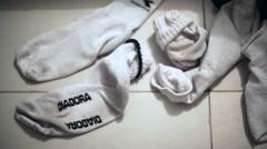 Diadora pile of dirty socks, close up, shallow focus Stock Footage
