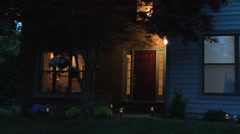 Establishing shot of front door at twilight in spring Stock Footage