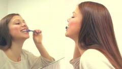 Young attractive woman brushing her teeth Stock Footage
