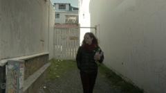 Woman Walks Downtown REYKJAVIK, ICELAND Stock Footage
