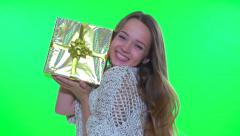 Happy excited girl on green screen presenting her gift - stock footage