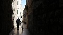 Man walking with the bike in the narrow streets Split, Croatia Stock Footage