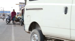 Mini van parking by busy street in Jodhpur. Stock Footage