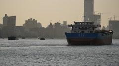 Ship moving along Shanghai bund Stock Footage
