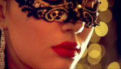 Sexy woman wearing venetian masquerade mask at party - stock footage