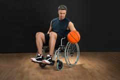 Disabled Basketball Player On Wheelchair Throwing Ball Stock Photos